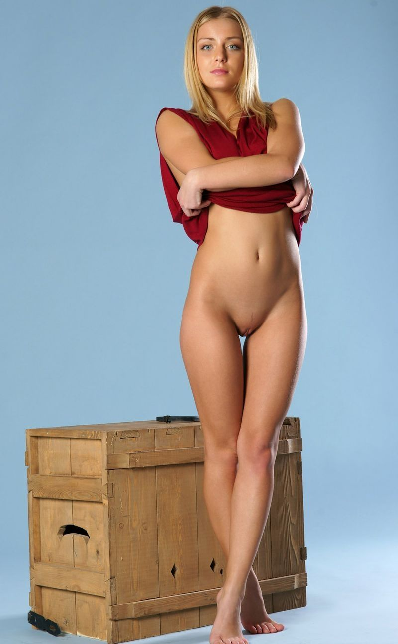golden blonde girl posing on wooden box