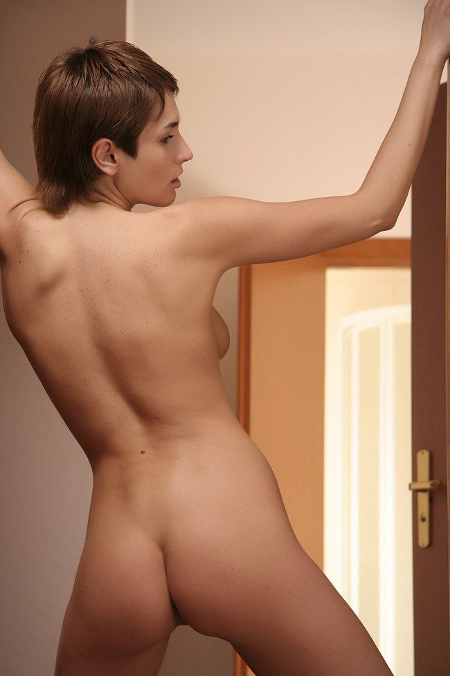 young brunette girl with short hair reveals at home