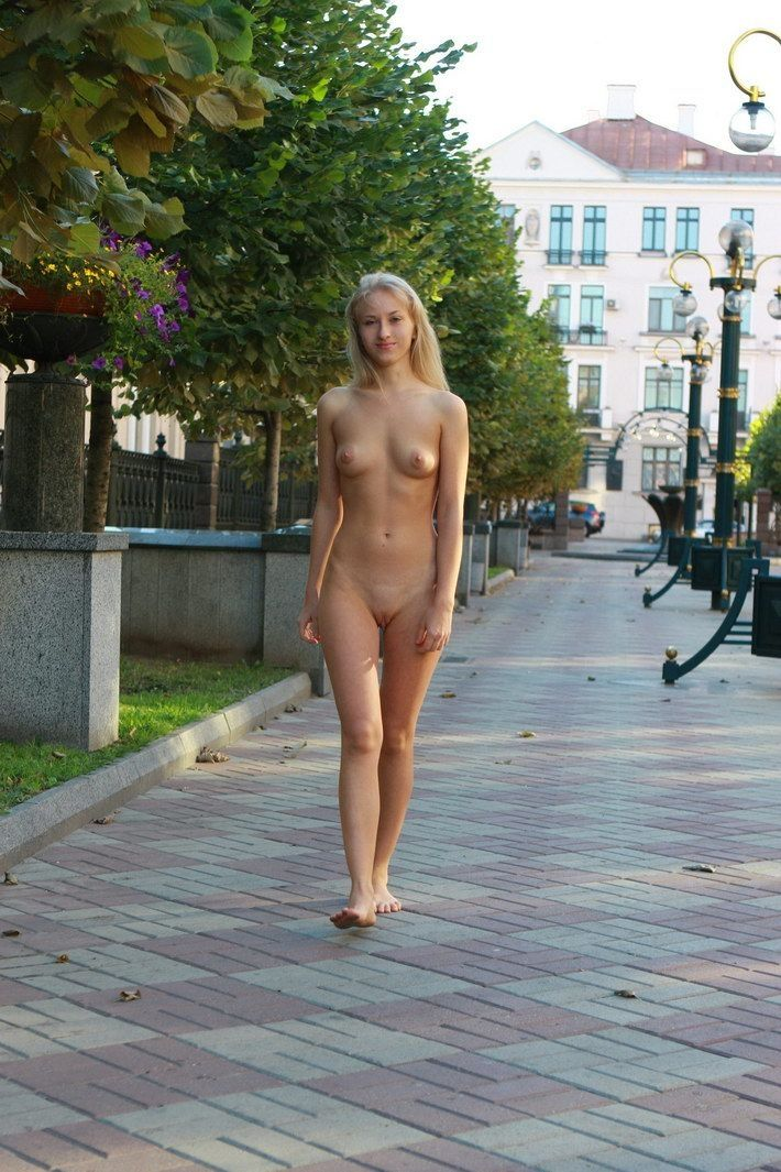 young blonde girl caught naked outdoors on the street