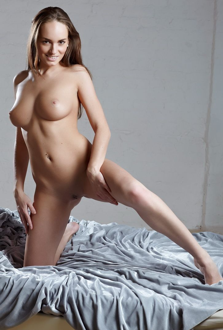 young brunette girl shows herself on the bed