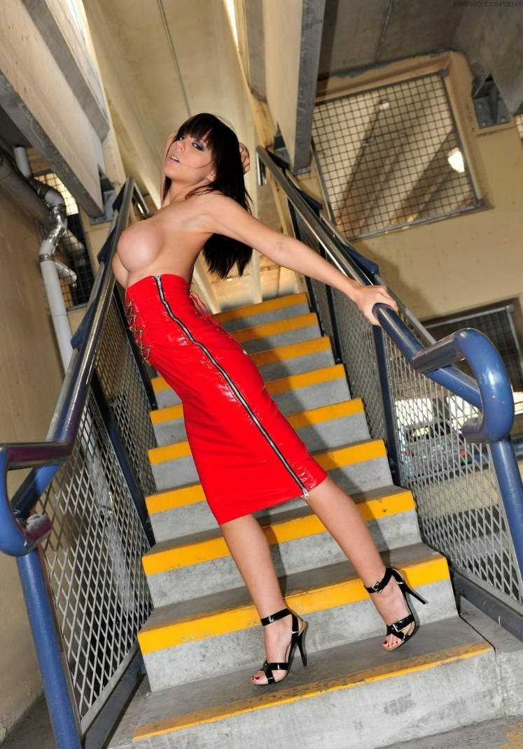 raven black haired girl on stairs in the red dress