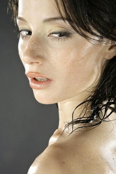 black haired girl oiled up in the studio