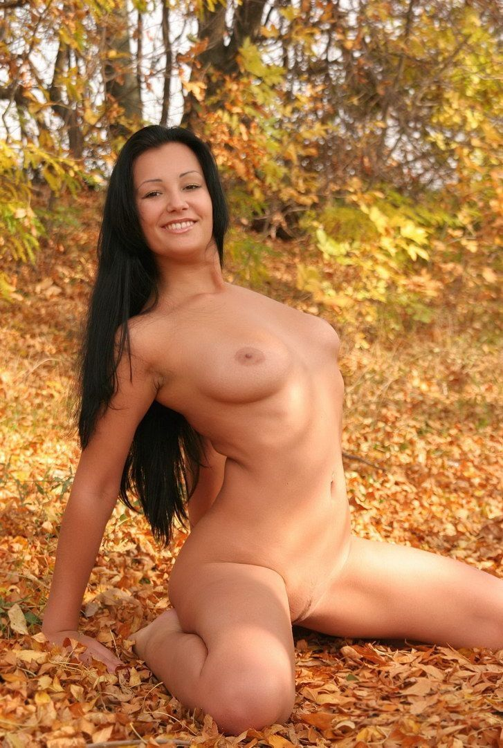 black haired girl outside in the autumn nature