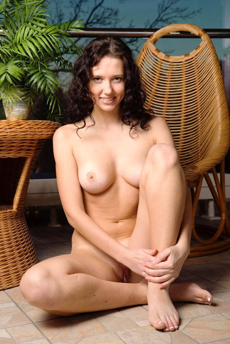 young curly brunette girl with the cane furniture