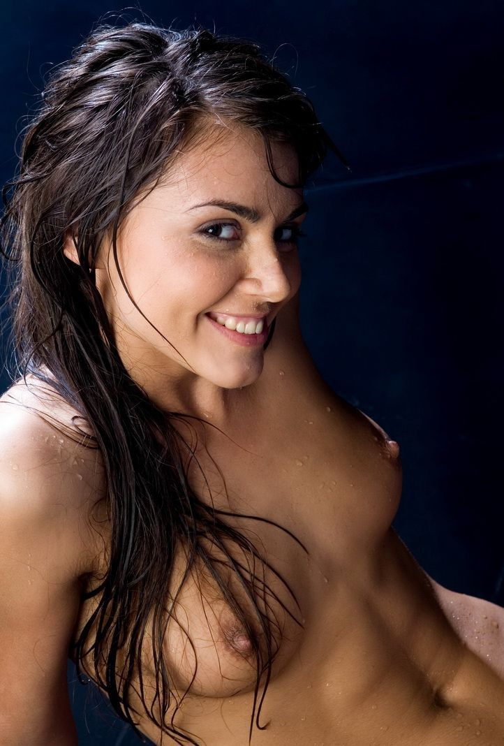 young brunette girl strips her black lingerie and getting wet in the studio
