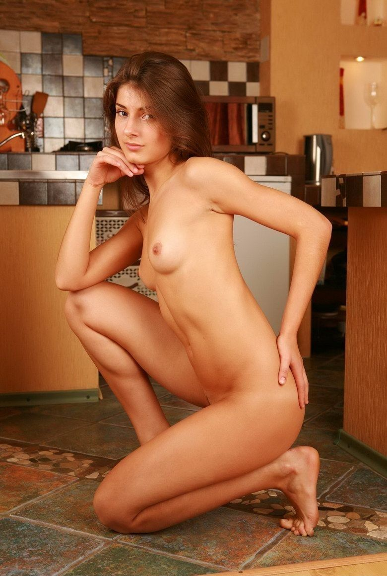 cute young brunette girl posing in the kitchen