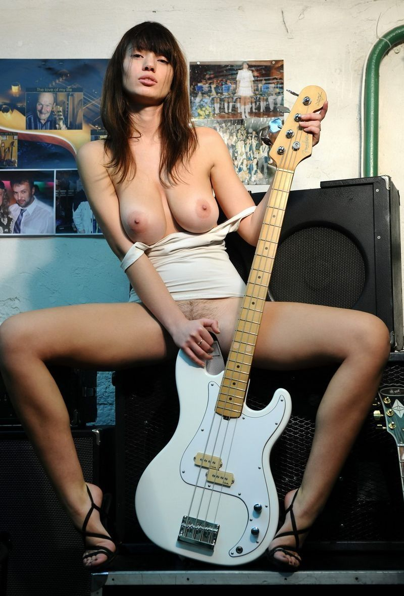 brunette girl posing with the guitar