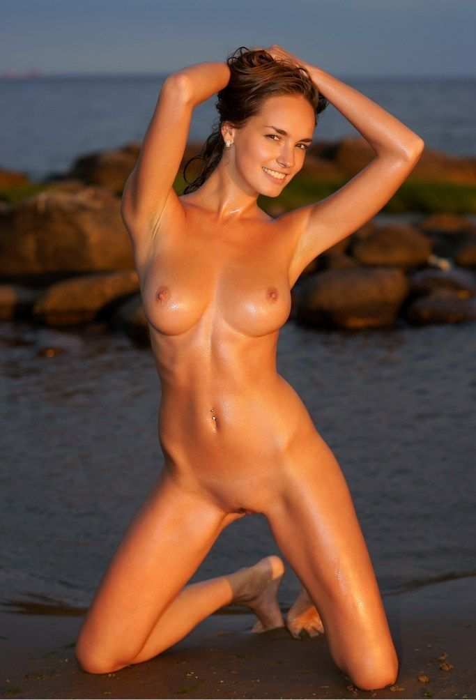 young brunette girl shows off her body on the beach