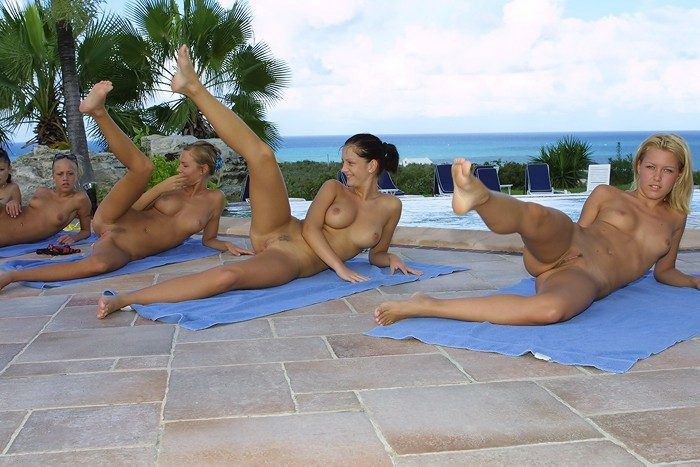 young girls outside at the pool doing physical exercises