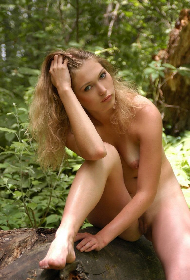 young blonde girl naked in the forest