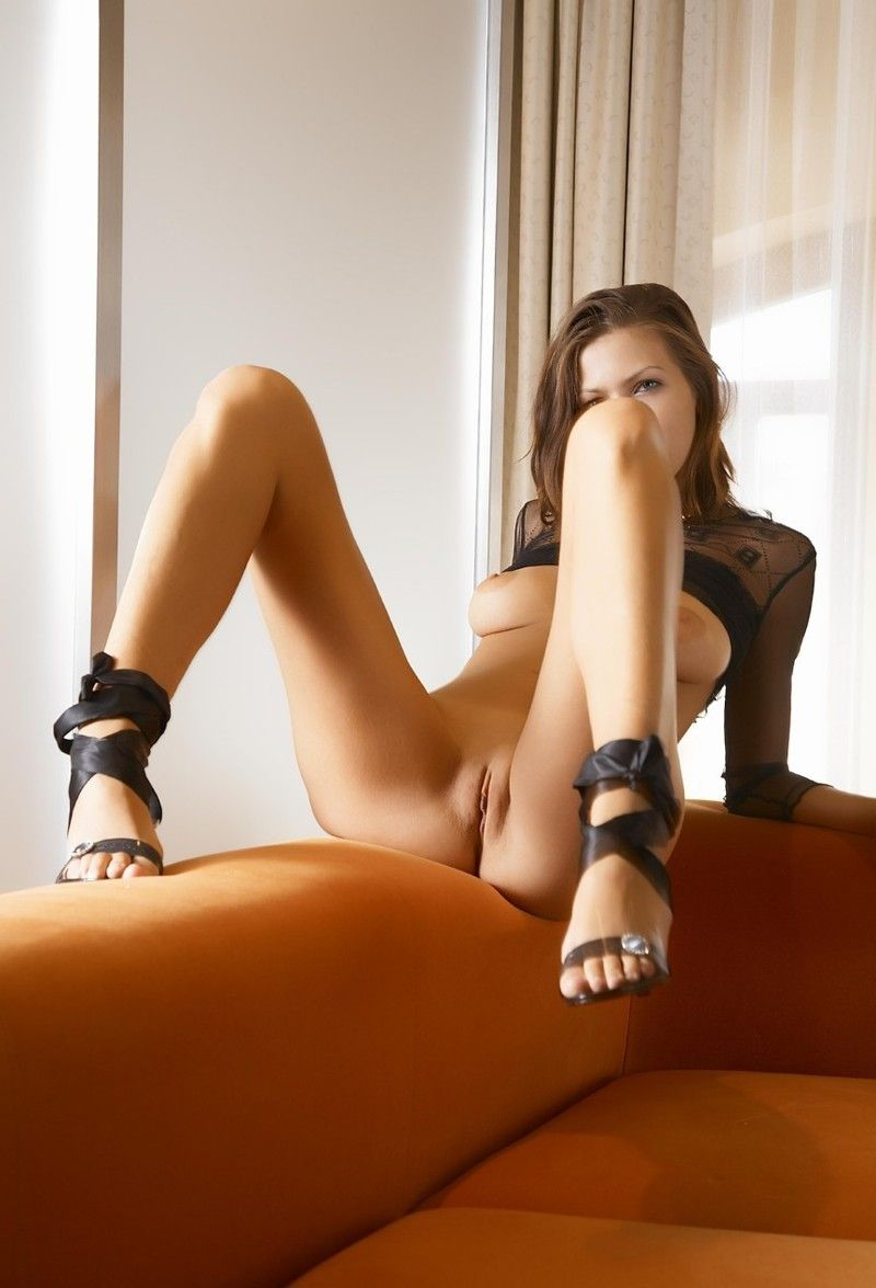 cute young brunette girl on the couch