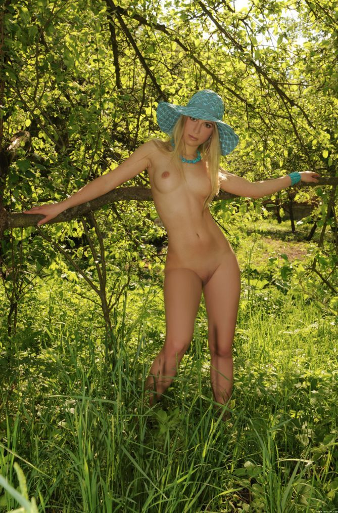 young blonde girl walking outside on open glades and meadows in the nature