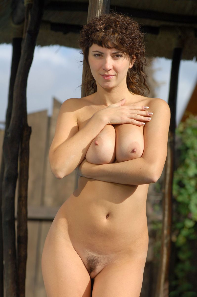 curly brunette girl shows off in the backyard