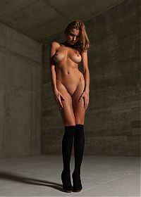 Babes: young brunette girl in black clothes and stockings
