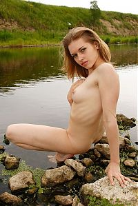 Nake.Me search results: young strawberry blonde girl strips her bikini at the river
