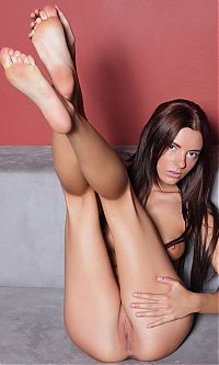 Babes: young brunette girl reveals in black tights with a knife