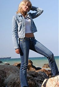 Nake.Me search results: young blonde girl gets undressed from jeans on the rocky beach