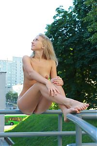 Babes: young blonde girl caught naked outdoors on the street