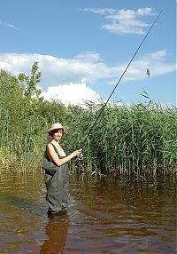 Babes: young brunette fish girl fishing in the swampland