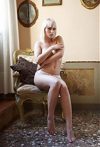 Babes: young swedish blonde girl posing in the old armchair