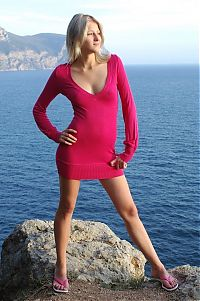 Nake.Me search results: cute young blonde girl posing on rocks in a tight pink sweater