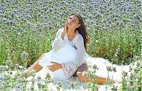 Babes: brunette girl on the field of wild flowers