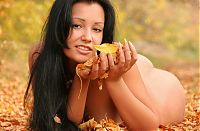 Babes: black haired girl outside in the autumn nature
