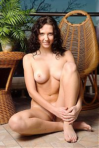 Babes: young curly brunette girl with the cane furniture