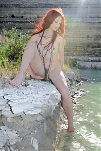 Babes: young red haired girl by the lake with blue necklace