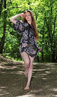 Nake.Me search results: young brunette girl with long hair and blue eyes strips her dress on the forest pathway