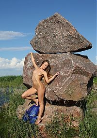 Babes: young dark blonde girl on rocks with a blue scarf