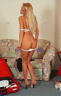 Babes: blonde girl with long hair posing at home