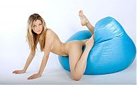 Nake.Me search results: blonde girl strips on the blue inflatable chair