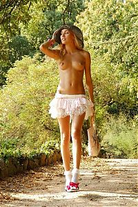 Babes: young blonde girl with a white skirt and hat on a forest pathway