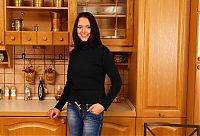Nake.Me search results: young black haired girl reveals in the kitchen
