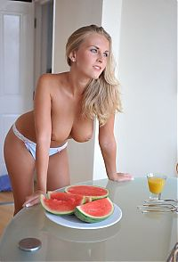 Babes: blonde girl having a breakfast with a watermelon