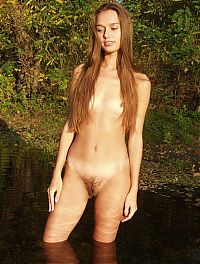 Babes: cute young brunette girl outside in the pond