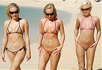 Nake.Me search results: three young blonde girls wearing extreme bikini on the beach