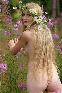 Nake.Me search results: young blonde girl outside making a daisy wreath