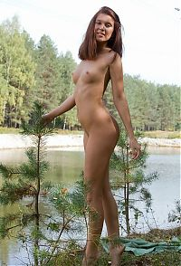 Babes: young brunette girl outside in the forest