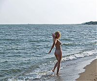 Babes: blonde girl posing in the sea