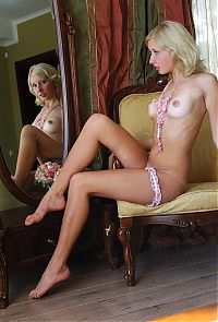 Babes: young blonde girl on the antique chair