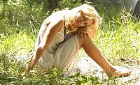Babes: young blonde girl reveals in a white chemise on a forest pathway