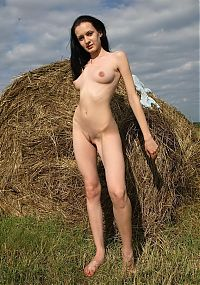 Babes: young black haired girl at the haystack