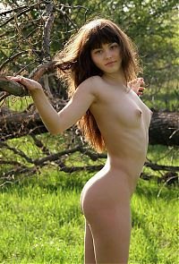 Nake.Me search results: young brunette girl naked by the tree