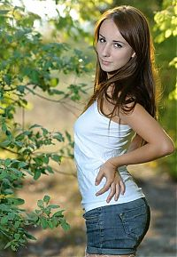 Nake.Me search results: young brunette girl strips on the forest glade