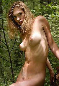 Nake.Me search results: young blonde girl naked in the forest