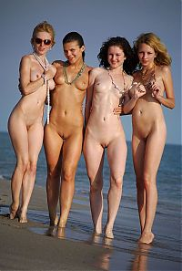 Nake.Me search results: four young girls relaxing on the beach