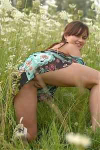 Nake.Me search results: young brunette girl on the field of wild flowers