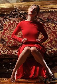 Nake.Me search results: blonde girl wearing red dress on the antique couch